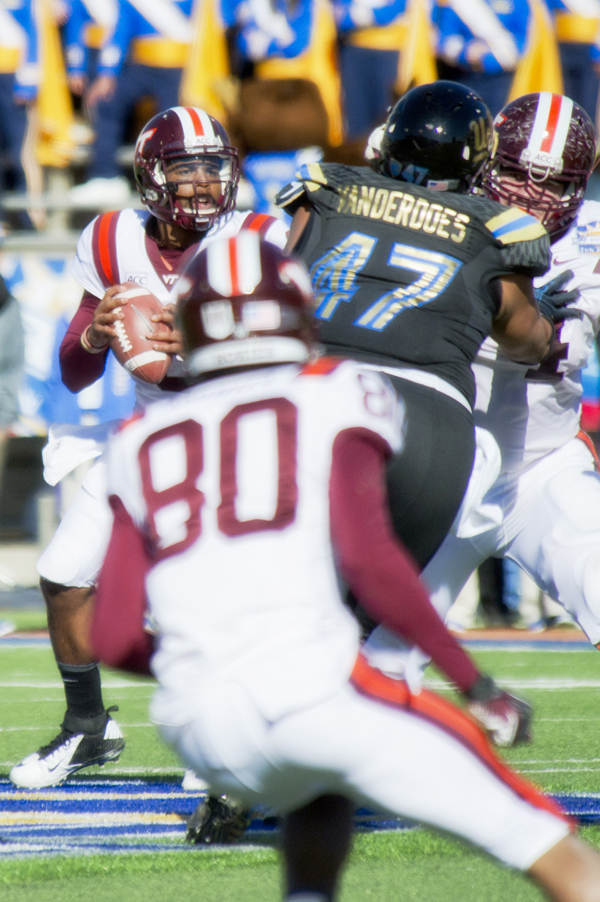 Eddie Vanderdoes (No. 47 in photo) was picked by the Oakland Raiders in the third round. He is pictured here going after the Virginia Tech quarterback during the 2013 Hyundai Sun Bowl